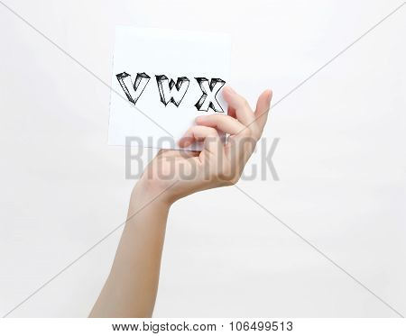 Hand Holding A Piece Of Paper With Sketchy Capital Letters V W X, Isolated On White.