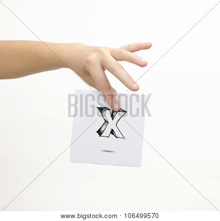 Hand Holding A Piece Of Paper With Sketchy Capital Letter X, Isolated On White.