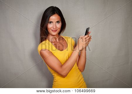 Charismatic Young Woman Holding Smart Phone