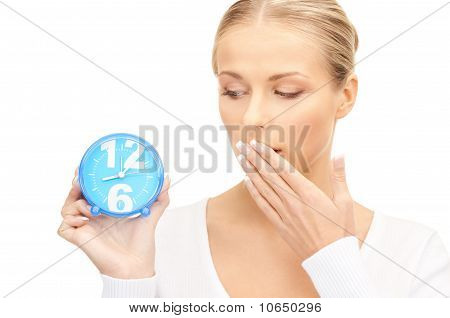 Woman Holding Alarm Clock