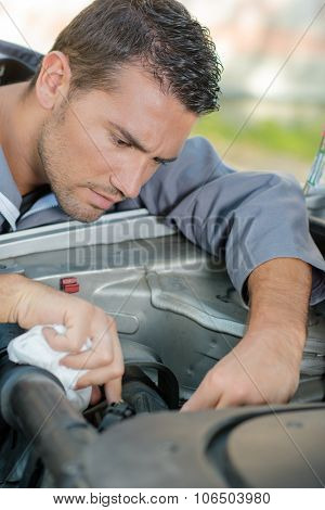 Mechanic working hard on a car repair