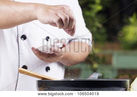 Chef Putting Salt To The Pan