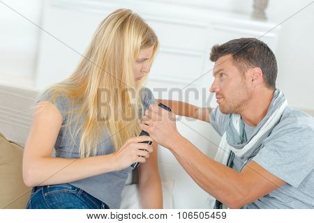 Couple gripping remote control