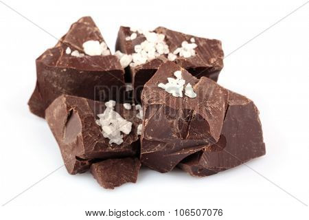 Black chocolate pieces with salt isolated on white