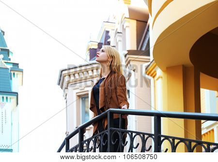 Elegant lady in the street of old city