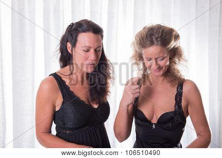 Two Women In Black Underwear Talking