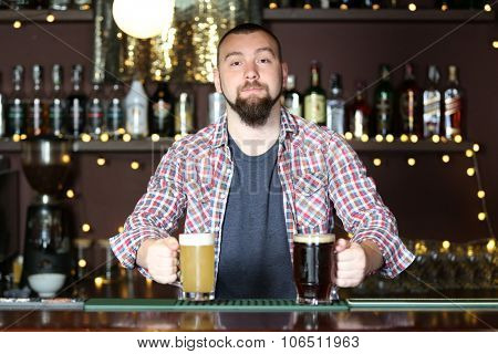 Portrait of handsome bartender at workplace