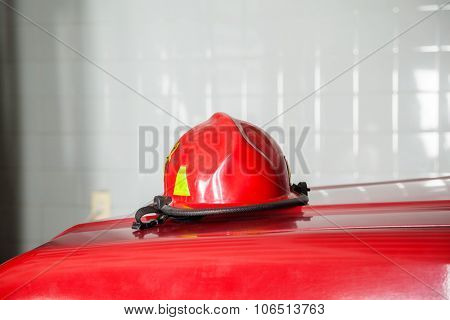 Closeup of red helmet on truck at fire station
