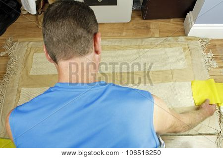 Man Placing Anti Slip Rug Grips