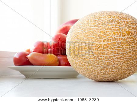 The red Tomato and yellow Melon.