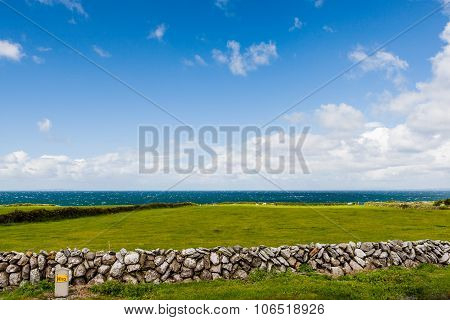 Green Lawn And Stone Wall In Front Of The North Atlantic