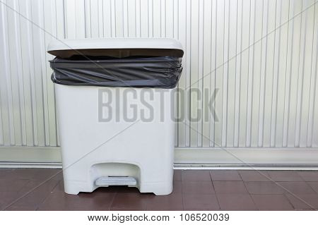 Black Bag Plastic In White Trashcan Bin