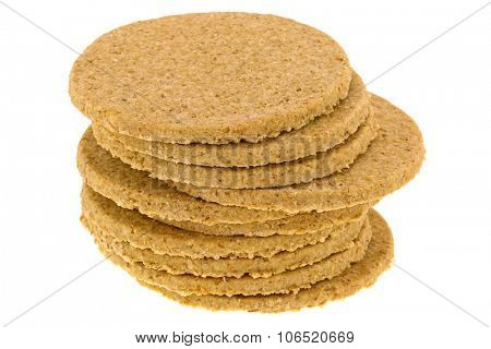 A stack of gluten free crumbly rough Oatcakes, isolated on white background