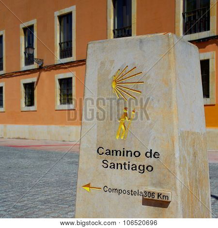 Way of Saint James stone sign in Leon 306 km to Santiago