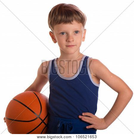 The Boy Held A Basketball Ball To A Hip.
