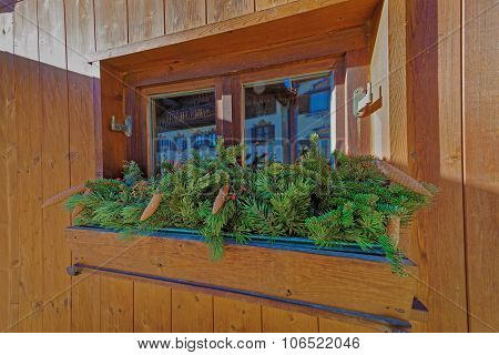 Wooden Window Box Filled With Fir Branch With Cones
