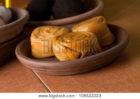 Three Pieces Smoked Rolled Cheeses On Bowl