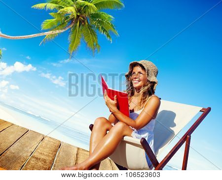 Woman Reading on Beach Relaxation Resting Concept