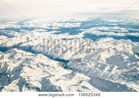 Aerial View Of Italian Alps With Snow And Misty Horizon - Travel Concept And Winter Vacation