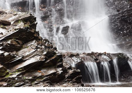 Waterfall On The Rocks Below