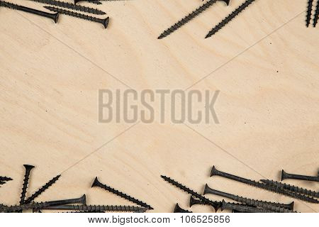 Screws on top and bottom of the wood plate