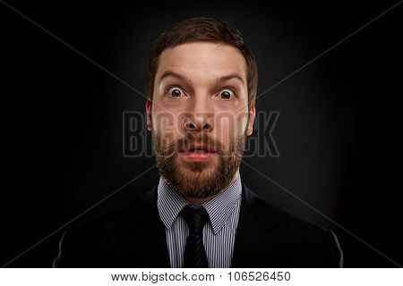 Closeup Portrait Of Happy Young Handsome Businessman Looking Shocked Surprised In Full Disbelief Ope