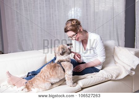 Attractive Woman On Couch With Her Dog