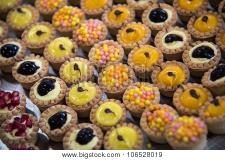 Variation Of Pastry Decorated With Various Fruits