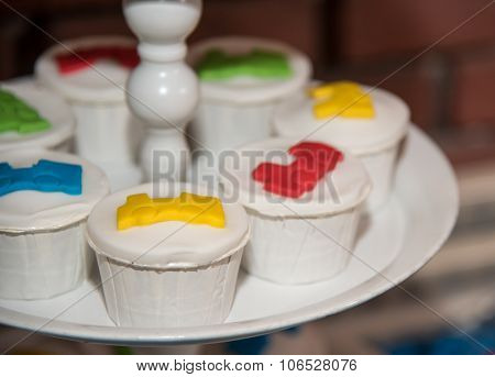 White Cupcakes Decorated With Colored Sweets