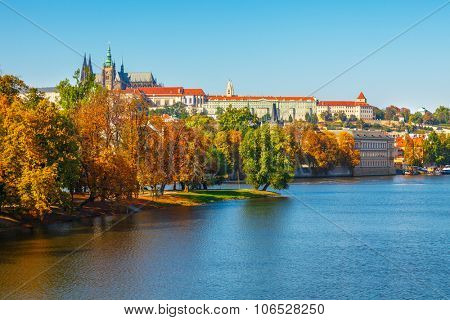 Autumn Prague castle over river Vltava Czech Republic. Illustration