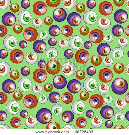 Colorful big eye balls on a green background