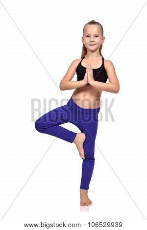 Girl Doing Yoga Exercises In Blue Clothing
