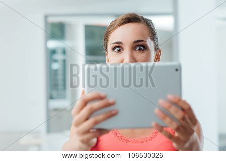 Excited Woman Holding A Tablet