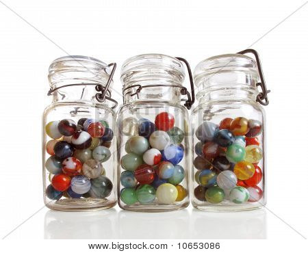 Three Jars Of Marbles