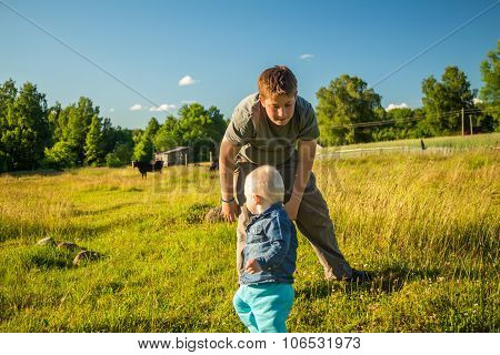 Two Boys  Playing On A Meadow.