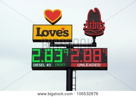 Loves Gas Station Travel Center And Arby's Signs Featuring The Price Of Gas