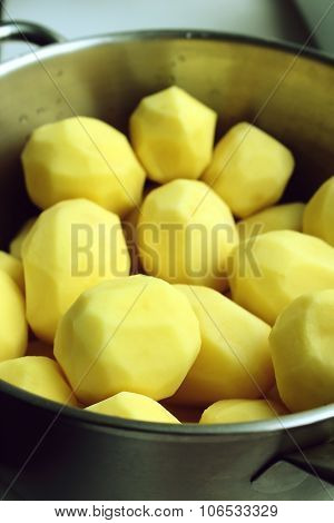 New peeled potatoes in a pot for cooking