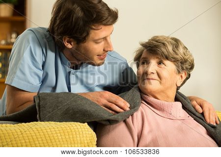 Male Nurse Caring About Retiree