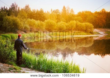 Fisherman Catches Of Fish On River