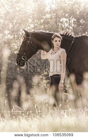 Vintage Young Equestrian Woman With Horse In Summer Sun Nature