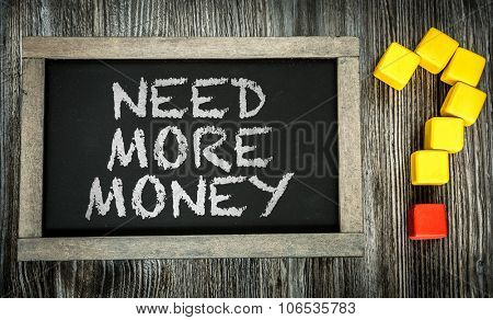 Need More Money? written on chalkboard