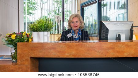 Re-integrating into the working process as a receptionist of a large firm.