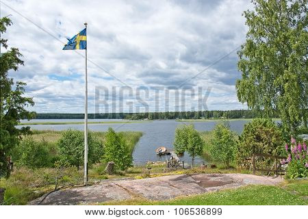 Swedish flag flying on pole