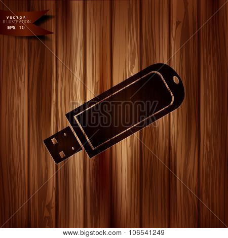 Usb flash drivo web icon. Wooden background