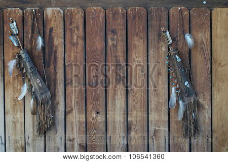 tribal native american feather and bow background on the wooden fence