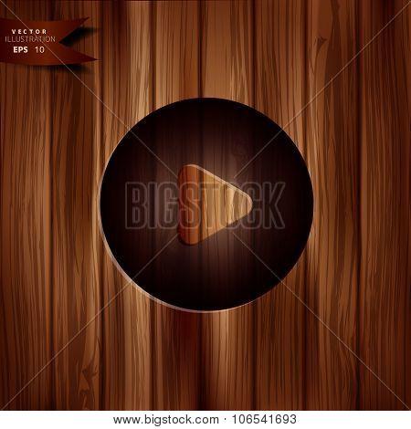 Media play icon. Start symbol. Wooden texture.