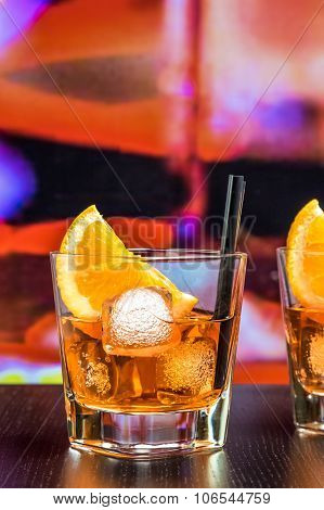 Glasses Of Spritz Aperitif Aperol Cocktail With Orange Slices And Ice Cubes On Bar Table, Color Pop