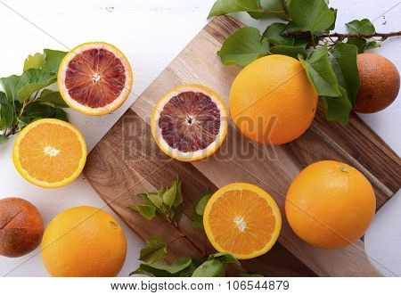 Mixed Oranges On Chopping Board
