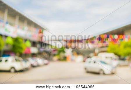 Image Of Blur Car Park At Shop On Day Time
