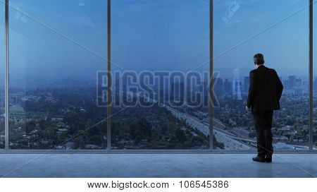 Business man looking through a window at big urban city (3D Rendering)